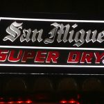 San Miguel super dry sign at blue abyss resort bar